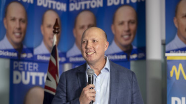 Home Affairs Minister Peter Dutton celebrates his return to the seat of Dickson while in Strathpine on election night.