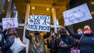 Demonstrators rally for New York Governor Andrew Cuomo's resignation in front of his Manhattan office in New York.