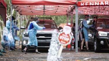 Sydneysiders line up to be tested at a pop-up clinic at Frenchs Forest in Sydney.