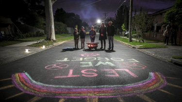 Mark Di Pasquale's daughters wrote 'lest we forget' in chalk on the street.