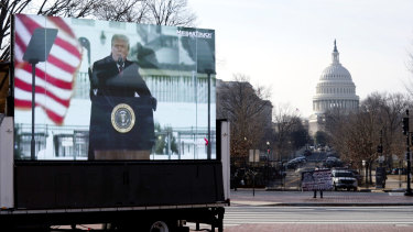 A photo of former President Donald Trump appears on a billboard truck parked near of the US Capitol during the impeachment trial.