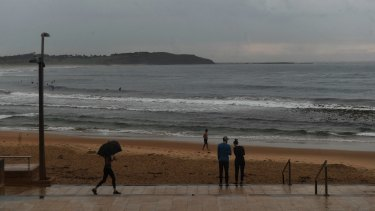 A wet and quiet morning on Dee Why beach as rain falls across the Sydney region.