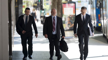 Witness Phillip Elliott (centre) arriving at ICAC for the inquiry into former MP Daryl Maguire.