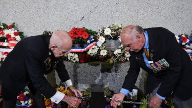 Wreaths are laid in Martin Place during the Anzac Day dawn service.