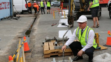 Sunshine Coast Mayor Mark Jamieson watches as the fibre-optic telecommunications cable is prepared to link Queensland with Asia.