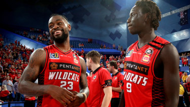 Running wild: Perth players Terrico White (left) and Wani Swaka Lo Buluk celebrate going 2-1 up in the grand final series.