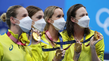 The victorious women's 4x100m freestyle team with their gold medals on Sunday.