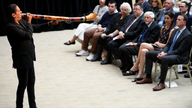 William Barton gives a didgeridoo performance at the State Memorial Service for Les Murray.