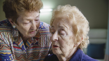 Irena Zuraszek, 91, takes care of her sister Wanda Solomon, 94, at Jindalee Aged Care Residence in Canberra.