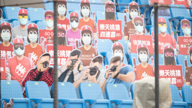 Cardboard cutouts of fans before prior to the baseball season opening game last year. It was played behind closed doors as Taiwan took strong early action against the pandemic.