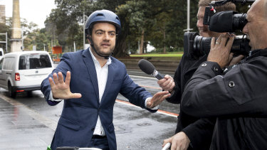 Sam Dastyari arrives on a Lime bike to give evidence at the inquiry into alleged illegal donations to the Labor Party.