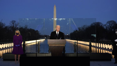 President-elect Joe Biden speaks during a COVID-19 memorial, with lights placed around the Lincoln Memorial Reflecting Pool.