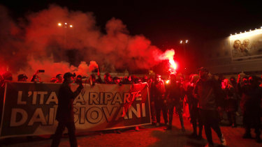 Tighter restrictions in Italy have triggered protests in Rome.