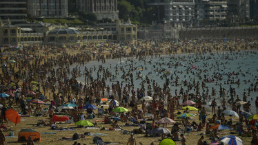 Huge crowds swarm beaches in San Sebastian, northern Spain, during the country's heatwave.