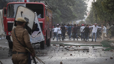 Protesters burnt tires and blocked highways and rail tracks for a second day as the upper house of Parliament began debating legislation that would grant citizenship to persecuted Hindus and other religious minorities but not Muslims.
