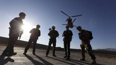 American soldiers wait on the tarmac in Logar province, Afghanistan.