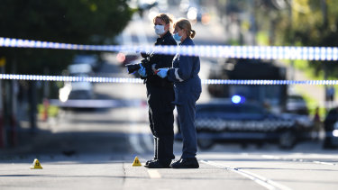 Forensic police work at the scene of a stabbing in Kew