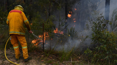 RFS crews continued to contain the Gospers Mountain Fire north-west of Sydney on Tuesday.