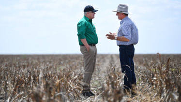 Prime Minister Scott Morrison with farmer David Gooding on his drought-affected property near Dalby, Queensland.