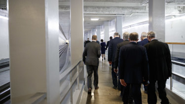 US senators are escorted by US Capitol police through tunnels to a safe location after Trump supporters breached the US Capitol last week.