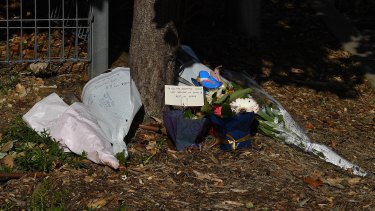 Flowers at the entrance to Anglicare's Newmarch House, where 16 residents have died from COVID-19.