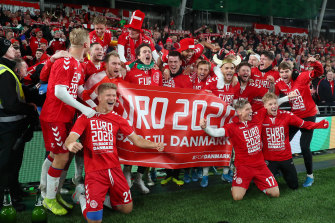 Danish players celebrate their qualification for Euro 2020.