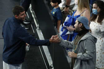 Michail Pervolarakis of Greece greets fans during day four of the 2021 ATP Cup on February 5 in Melbourne.