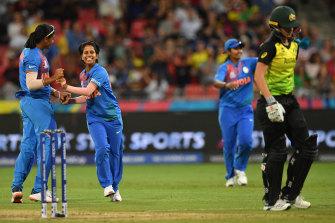 Poonam Yadav sends Jess Jonassen on her way during her spell of 4-19 in Australia's opening match.