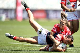 St George Illawarra's Isabelle Kelly brings down Sydney Roosters skipper Corban McGregor.