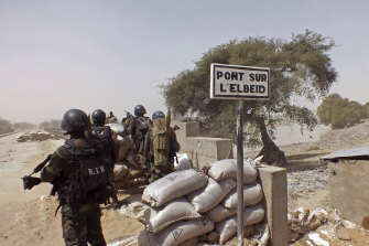 In this 2015 file photo, Cameroon soldiers stand guard at a lookout post as they take part in operations against the Islamic extremists group Boko Haram.