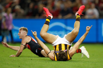 Tom Phillips celebrates a goal for the Hawks in their comeback win over Essendon.