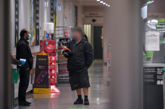 One shopper at the Woolworths in Fitzroy was not wearing a mask on Thursday.