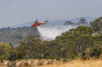 Experts are calling for a change in firefighting tactics, including the rapid water-bombing of new fires.