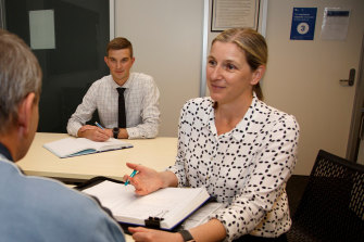 Box Hill family violence detectives Brendan Cunningham (middle) and Kristina Lucic speak with an older Victorian.