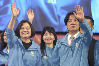 Taiwanese President Tsai Ing-wen, left, waves to supporters while launching her re-election campaign in Taipei in November.