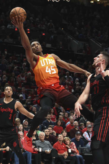 Utah's Donovan Mitchell goes for the shot.