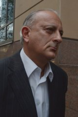 Bill Jordanou leaves court.