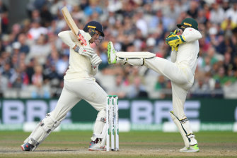 Australia's Tim Paine takes the ball during day five of the fourth Test.