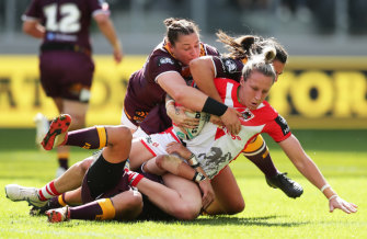 Holli Wheeler is brought down during the Dragons' round one clash with the Broncos at Bankwest Stadium.