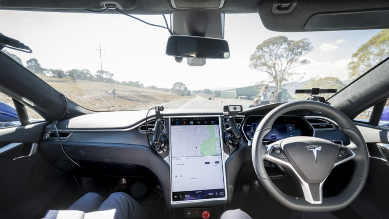 The view from behind the wheel of a Tesla vehicle fitted with Seeing Machines' driver monitoring technology.