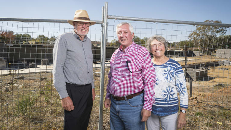 Giralang Residents Action Group members Bill Burmester and Ross and Olga Calvert, at the site of the old Giralang shops after redevelopment plans were submitted last month.