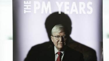 A shadow of former prime minister Kevin Rudd is cast on a promotional banner during the launch of his book at Parliament House on Tuesday.