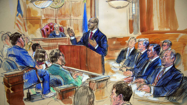 This courtroom sketch depicts Paul Manafort, seated right row second from right, together with his lawyers, the jury and the US District Court Judge TS Ellis.