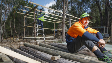 Volunteers Jacques Slater-McCabe, 12, and Cooper Temple-Clarke, 15, are taking time out of their school holidays to help restore Tidbinbilla Hut.
