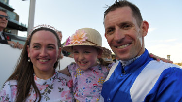 Happy family: Hugh Bowman with wife Christine and daughter Bambi after Winx's win on Saturday.