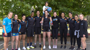 Daliah Lee (on the shoulders of Lauren Scherf) meets hers favourite team - the UC Canberra Capitals.