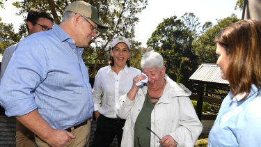 Australian Prime Minister Scott Morrison (left), wife Jenny (right) and Queensland LNP Leader Deb Frecklington meet with Pamela Skeen who had lost her home in bushfire-affected suburb of Binna Burra in the Gold Coast Hinterland.