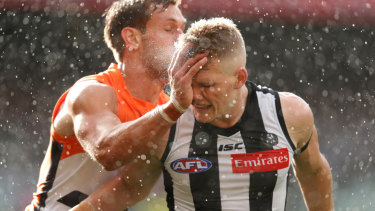 When rains, it pours: Star Collingwood midfielder Adam Treloar struggled to make an impact in the prelim final against Greater Western Sydney at the MCG.