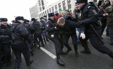 Police officers detain a demonstrator at the Free Internet rally in Moscow on Sunday.