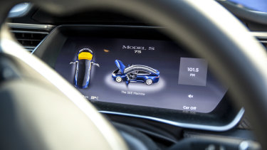 The interior of a Tesla equipped with Seeing Machines' driver monitoring technology.